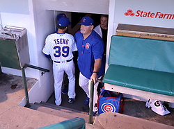 September 14, 2017 - Chicago, IL, USA - Chicago Cubs starting pitcher Jen-Ho Tseng passes by pitching coach Chris Bosio before Tsung's major league debut against the New York Mets at Wrigley Field in Chicago on Thursday, Sept. 14, 2017. (Credit Image: © Chris Sweda/TNS via ZUMA Wire)