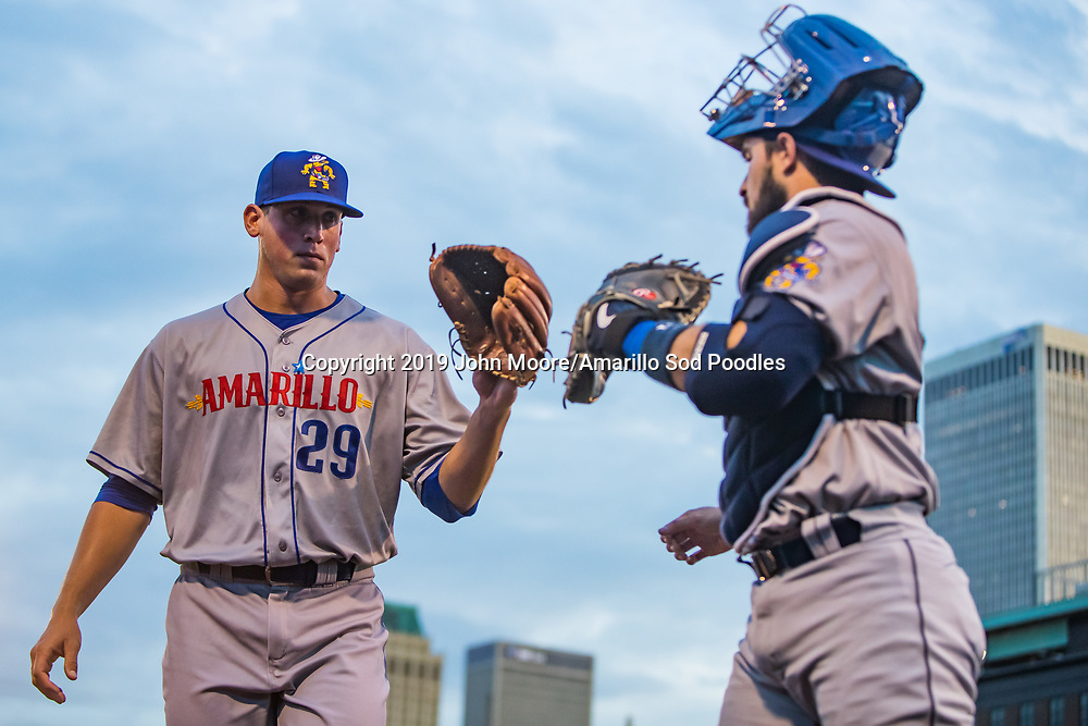Amarillo Sod Poodles pitcher Kyle Lloyd (29) and Amarillo Sod Poodles catcher Luis Torrens (21) against the Tulsa Drillers during the Texas League Championship on Friday, Sept. 13, 2019, at OneOK Field in Tulsa, Oklahoma. [Photo by John Moore/Amarillo Sod Poodles]