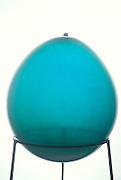 one blue balloon on a pedestal