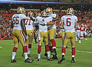 KANSAS CITY, MO - AUGUST 16:  Wide receiver Chuck Jacobs #1 of the San Francisco 49ers celebrates with hit teammates after scoring on a 14-yard touchdown pass the Kansas City Chiefs during the second half on August 16, 2013 at Arrowhead Stadium in Kansas City, Missouri.  The 49ers won 15-13. (Photo by Peter Aiken/Getty Images) *** Local Caption *** Chuck Jacobs