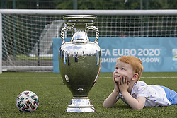 Handout photo dated 02/06/2021 provided by JSHPIX of Glasgow youngster Hugo getting their first look at Euro 2020 trophy as the Henri Delaunay Cup made a special visit to Glasgow's Walking Football programme today as part of the UEFA EURO 2020 Trophy Tour. Issue date: Wednesday June 2, 2021.