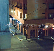 I was about a block away on my hotel balcony and I see this guy playing guitar in the dead of night.  Nobody around.  I shot it wih a small Canon S70 digital point and shoot camera.  Photoshopped it into a painting.