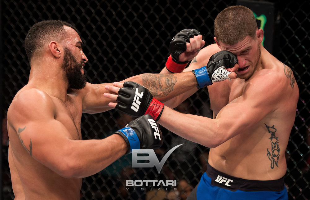 LAS VEGAS, NV - DECEMBER 03:  (L-R) Devin Clark punches Josh Stansbury in their light heavyweight bout during The Ultimate Fighter Finale event inside the Pearl concert theater at the Palms Resort & Casino on December 3, 2016 in Las Vegas, Nevada. (Photo by Jeff Bottari/Zuffa LLC/Zuffa LLC via Getty Images)