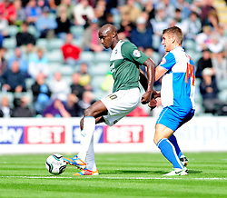 Plymouth Argyle's Marvin Morgan holds the ball up from Bristol Rovers' Lee Brown  - Photo mandatory by-line: Dougie Allward/JMP - Tel: Mobile: 07966 386802 07/09/2013 - SPORT - FOOTBALL -  Home Park - Plymouth - Plymouth Argyle V Bristol Rovers - Sky Bet League Two