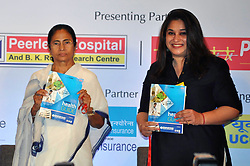 September 6, 2017 - Kolkata, West Bengal, India - Chief Minister Mamata Banerjee (left) and General Manager East, The Indian Express, Sanghamitra Kumar (right) hold the health guide during the Round table conference in Kolkata. (Credit Image: © Saikat Paul/Pacific Press via ZUMA Wire)