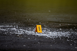 © Licensed to London News Pictures . 29/12/2018 . Wigan , UK . Police forensic marker at the scene where a stretch of Bickershaw Lane in Abram has been taped off . Greater Manchester Police report they have arrested two people on suspicion of attempted murder and for conspiracy to commit attempted murder , respectively , after a 21-year-old man sustained life-threatening injuries yesterday evening (Friday 28th December 2018) . Photo credit : Joel Goodman/LNP