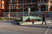 "The bronze sculpture of a boy forms part of the artwork by Kenny Hunter in Walworth Square at Elephant And Castle on 9th March 2021, in London, England. Its full inscription reads ""Against the armour of the storm I'll hold my human barrier"" – a line from a World War Two poem by Hamish Henderson. The striking bronze artwork has been installed in the year that marks the centenary of the Armistice and the end of the First World War. The sculpture has been commissioned to commemorate all the lives that have been affected by war and conflict around the globe, including the lives of members of the armed forces, civilians, refugees and others."