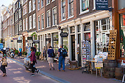 Tourists shopping along Herenstraat in the Nine Streets - De Negen Straatjes - 9 Streetss district of Jordaan, Amsterdam