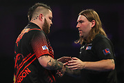 Michael Smith wins his fourth round match against Ryan Searle and celebrates during the World Darts Championships 2018 at Alexandra Palace, London, United Kingdom on 28 December 2018.
