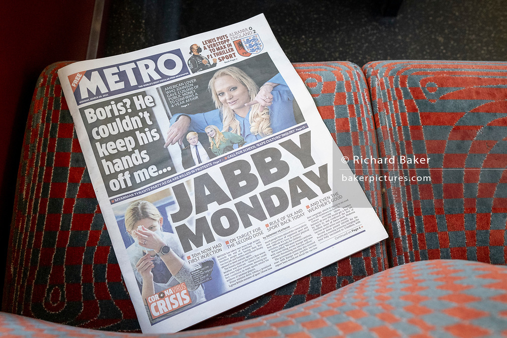 A discarded copy of a Metro newspaper, reporting on Prime Minister Boris Johnson's alleged affair with Jennifer Arcuri and the date when Covid pandemic lockdown restrictions are further relaxed, lies on the seats of a London bus, on 29th March 2021, in London, England.