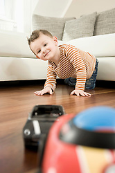 Portrait of boy playing with toys, smiling