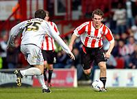 Photo: Alan Crowhurst.<br />Brentford v Bradford City. Coca Cola League 1. 08/04/2006. Jay Tabb (R) attacks for Brentford