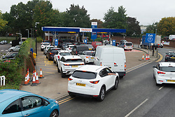 © Licensed to London News Pictures 08/10/2021.<br /> Sidcup, UK, Motorists queuing for fuel at Tesco's petrol station in Sidcup, South East London. The petrol shortage continues in London and the South East with retailers calling for an inquiry into the fuel crisis. Photo credit:Grant Falvey/LNP