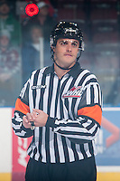 KELOWNA, CANADA - DECEMBER 5: Referee Steve Papp stands at centre ice between the Kelowna Rockets and the Prince George Cougarson December 5, 2014 at Prospera Place in Kelowna, British Columbia, Canada.  (Photo by Marissa Baecker/Shoot the Breeze)  *** Local Caption *** Steve Papp;