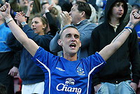Photo: Andrew Unwin.<br />Middlesbrough v Everton. The Barclays Premiership. 29/04/2006.<br />An Everton fan cheers on his team.