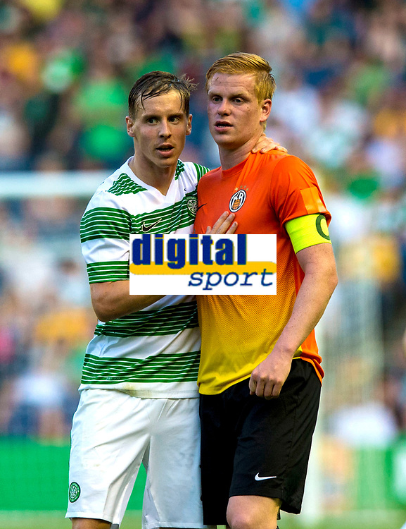 22/07/14 UEFA CHAMPIONS LEAGUE 2ND QUALIFYING ROUND 2ND LEG<br /> CELTIC v KR REYKJAVIK<br /> BT MURRAYFIELD STADIUM - EDINBURGH<br /> Celtic ace Stefan Johansen (left) with Baldur Sigurdsson