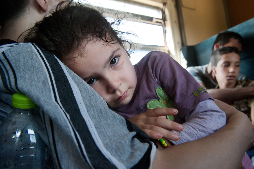 Noon, Sunday 13th of September 2015. Sham looks at me, few minutes ago she was crying.  They are on a special train just for refugees and immigrants from Gevgelija toSlanishte , across the Republic of Macedonia. It's overcrowded, hot and there are no lights, so everytime we pass through a tunnel is pitch black and the girls are scared.