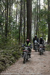 Mohamad Khurshid riding through the forest out from the Kusma Gyadi Bridge on Day-7 of our Himalayan Heroes adventure riding from Tatopani to Pokhara, Nepal. Monday, November 12, 2018. Photography ©2018 Michael Lichter.