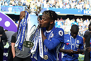 Michy Batshuayi of Chelsea kisses the Premier league trophy after the game. Premier league match, Chelsea v Sunderland at Stamford Bridge in London on Sunday 21st May 2017.<br /> pic by Steffan Bowen,  Andrew Orchard sports photography.