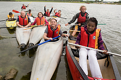 Adam Bates (second from left) Guinness Northern Counties Youth Coordinator, and Phil Roache Guinnesss Back Northern Counties Housing Officer with Kids from the Briary Close housing scheme in Wakefield and Pugneys country park staff member (second from Right) Kayaking Pugneys Country Park on Thursday  26 August 2010 .Images © Paul David Drabble..