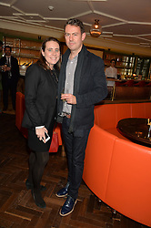 AMY DRUMMY (check spelling) and NIGEL COOKE at a party hosted by Pace Gallery as part of Frieze 2015 held at 45 Jermyn Street, London on 15th October 2015.