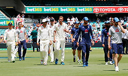 England's players look dejected after defeat during day five of the Ashes Test match at Sydney Cricket Ground.