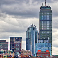 Boston skyline photography featuring the iconic Prudential Center in Back Bay along the Charles River. Partly cloudy skies were in the weather forecast and I was a bit hesitant to explore, but boy am I glad I went. The sailing boats added a color punch while the overcast sky showed beautiful grey tones in different cloud formations. <br /> This cloudy Boston skyline photo is available as museum quality photography prints, canvas prints, acrylic prints or metal prints. Wall art prints may be framed and matted to the individual liking and decorating needs:<br />  <br /> https://juergen-roth.pixels.com/featured/cloudy-skies-over-boston-back-bay-juergen-roth.html<br /> <br /> All overcast and cloudy Boston photos are available for digital and print photography image licensing at www.RothGalleries.com. Please contact me direct with any questions or request.<br /> <br /> Good light and happy photo making!<br /> <br /> My best,<br /> <br /> Juergen<br /> Prints: http://www.rothgalleries.com<br /> Photo Blog: http://whereintheworldisjuergen.blogspot.com<br /> Instagram: https://www.instagram.com/rothgalleries<br /> Twitter: https://twitter.com/naturefineart<br /> Facebook: https://www.facebook.com/naturefineart