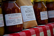 Stone ground grits and other local delicacies at the organic local produce farmers market in Marion Square in Charleston, South Carolina with St. Mathews Lutheran Church in the background (photo by Charleston SC photographer Richard Ellis)
