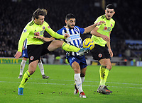 Football - 2019 / 2020 Premier League - Brighton & Hove Albion vs. Sheffield United<br /> <br /> John Egan and Luke Freeman of Sheff Utd combine to stop Neal Maupay, at The Amex.<br /> <br /> COLORSPORT/ANDREW COWIE