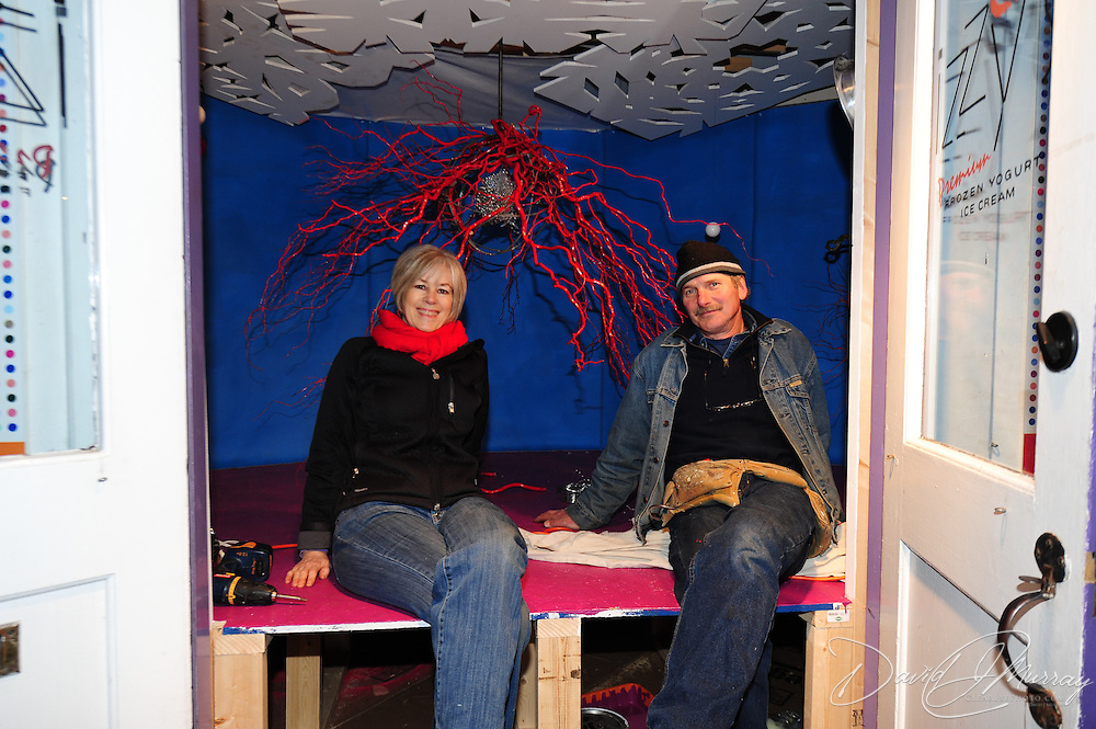 """Flavacomets"" by artists Kate Doyle, Brad Gordon and Ivan Stanek, is part of the 3S Artspace ""Flavor: A Collaborative Art Installation"" at Izzy's, 33 Bow Street, Portsmouth, NH. Doyle (L) and Stanek (R) shown here during the piece's installation."