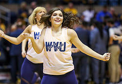 Dec 8, 2018; Morgantown, WV, USA; A West Virginia Mountaineers dancer performs during the first half against the Pittsburgh Panthers at WVU Coliseum. Mandatory Credit: Ben Queen-USA TODAY Sports