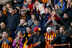 A Bradford City holds up a cardboard FA Cup  in the away stand - Photo mandatory by-line: Rogan Thomson/JMP - 07966 386802 - 24/01/2015 - SPORT - FOOTBALL - London, England - Stamford Bridge - Chelsea v Bradford City - FA Cup Fourth Round Proper.