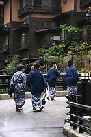 Out for a stroll in the streets of Kurokawa, onsen visitors regularly wear onsen yukata outside the onsen hotel before or after bathing.  Kurokawa Onsen is considered one of the most pleasant onsen towns in Kyushu for its lack of kitsch and sleaze found at other watering holes.