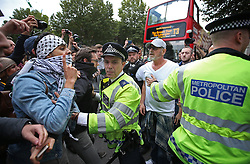 © Licensed to London News Pictures. 09/09/2015. London, UK. Pro-Palestinian protestors (L) are separated by policeman  from Israeli demonstrators outside the gates of Downing Street ahead of a visit by Israeli Prime Minister Benjamin Netanyahu. Photo credit: Peter Macdiarmid/LNP
