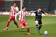 Crawley Town defender Nick Tsaroulla (25) battles for possession  with Stevenage midfielder Tom Pett (26) during the EFL Sky Bet League 2 match between Stevenage and Crawley Town at the Lamex Stadium, Stevenage, England on 1 May 2021.