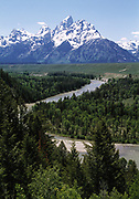 Winding Snake River with Grand Tetons covered with snow in distance