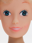 Extreme close up of a blond doll face.