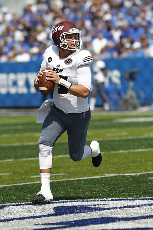 LEXINGTON, KY - SEPTEMBER 09: Austin Scott #15 of the Eastern Kentucky Colonels rolls out to pass the ball against the Kentucky Wildcats at Kroger Field on September 9, 2017 in Lexington, Kentucky. (Photo by Michael Hickey/Getty Images) *** Local Caption *** Austin Scott
