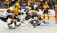 NASHVILLE, TN - JANUARY 12:  Ryan Johansen #92 of the Nashville Predators fights Tim Schaller #59 of the Boston Bruins for a lose puck in front of goalie Tuukka Rask #40 during the first period at Bridgestone Arena on January 12, 2017 in Nashville, Tennessee  (Photo by Frederick Breedon/Getty Images)