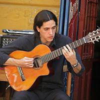 South America, Argentina, Buenos Aires. La Boca street guitarist.