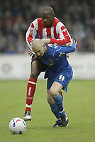 Photo: Aidan Ellis.<br /> Lincoln City v Grimsby Town. Coca Cola League 2, Play off Semi Final. 13/05/2006.<br /> Grimsby's Andy Parkinson holds off the challenge from Lincolnm's NaT Brown