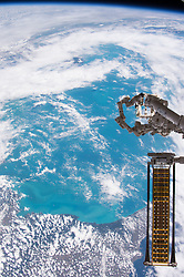 Jun 18, 2017 - Space - Over the weekend of June 17-18, 2017, engineers on the ground remotely operated the International Space Station's robotic Canadarm2 to extract the Roll Out Solar Array (ROSA) experiment from the SpaceX Dragon resupply ship. The experiment will remain attached to the Canadarm2 over seven days to test the effectiveness of ROSA, an advanced, flexible solar array that rolls out like a tape measure. Traditional solar panels used to power satellites can be bulky with heavy panels folded together using mechanical hinges. This new solar array's design rolls up to form a compact cylinder for launch with significantly less mass and volume, potentially offering substantial cost savings as well as an increase in power for satellites. (Credit Image: ? NASA via ZUMA Wire/ZUMAPRESS.com)