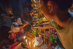 Incense offering at Buddhist altar deep within Bayon temple