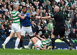 Referee Bobby Madden tries to break up a confrontation between Celtic's Scott Brown (left) and Rangers Alfredo Morelos after Morelos attempts to get the ball from Celtic's Kieran Tierney (floor) during the William Hill Scottish Cup semi final match at Hampden Park, Glasgow.