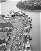 """Ackroyd 19177-1 """"Swan Island aerial. January 17, 1975"""" (Caption published on Daily Journal of Commerce January 24, 1975 pg. 1: """"Recession? Not at shipyards on Swan Island. Port of Portland reports drydocks and repair berths are busy this month after slow period late last year. Ship repair industry is feast or famine type business and in January we've been feasting, according to spokesman at Port."""""""
