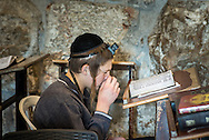 An ultra-orthodox child prays at the western wall. Education in the Haredi community is strictly segregated by sex. The education for boys is primarily focused on the study of Jewish scriptures, such as the Torah and Talmud.<br /> In Israel there are ongoing tensions between Haredi schools and the demands by government bodies to comply with education requirements of teaching core subjects. A broad based education is seen as necessary in alleviating poverty in the Haredi community, who are large recipients of government welfare.