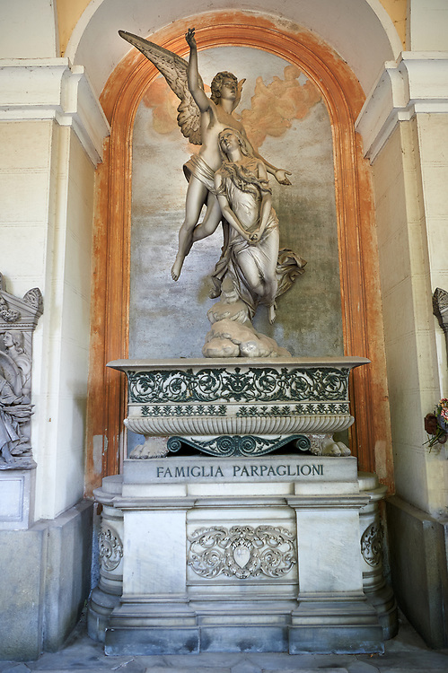 Picture and image of the stone sculpture commissioned by Luigi Parpaglioni, a rich trader coming from the Lombardy, because of his daughter's death. The funery monument depicts  flying angel going before the soul who is rising up to the sky.  This romantic style is typical of the pre raphilites and although realistic the style is a little stilted. The Papaglioni tomb became popular and was copied by sculptors in many other countries.  Tomb Parpaglioni sculptor F. Fabiani 1884. Section A, no 35, The monumental tombs of the Staglieno Monumental Cemetery, Genoa, Italy .<br /> <br /> Visit our ITALY PHOTO COLLECTION for more   photos of Italy to download or buy as prints https://funkystock.photoshelter.com/gallery-collection/2b-Pictures-Images-of-Italy-Photos-of-Italian-Historic-Landmark-Sites/C0000qxA2zGFjd_k<br /> If you prefer to buy from our ALAMY PHOTO LIBRARY  Collection visit : https://www.alamy.com/portfolio/paul-williams-funkystock/camposanto-di-staglieno-cemetery-genoa.html