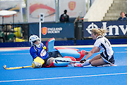East Grinstead's Sophie Bray beats Asha Tranquille-Day in the Slough goal. East Grinstead v Slough - Investec Women's Hockey League Finals Weekend, Lee Valley Hockey & Tennis Centre, London, UK on 18 April 2015. Photo: Simon Parker