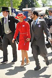 SHEIKH MOHAMMAD BIN RASHID AL MAKTOUM and his wife PRINCESS HAYA OF JORDAN at the second day of the 2010 Royal Ascot Racing festival at Ascot Racecourse, Berkshire on 16th June 2010.