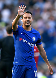 Chelsea's Pedro waves to the fans at the end of the Premier League match at Stamford Bridge, London.